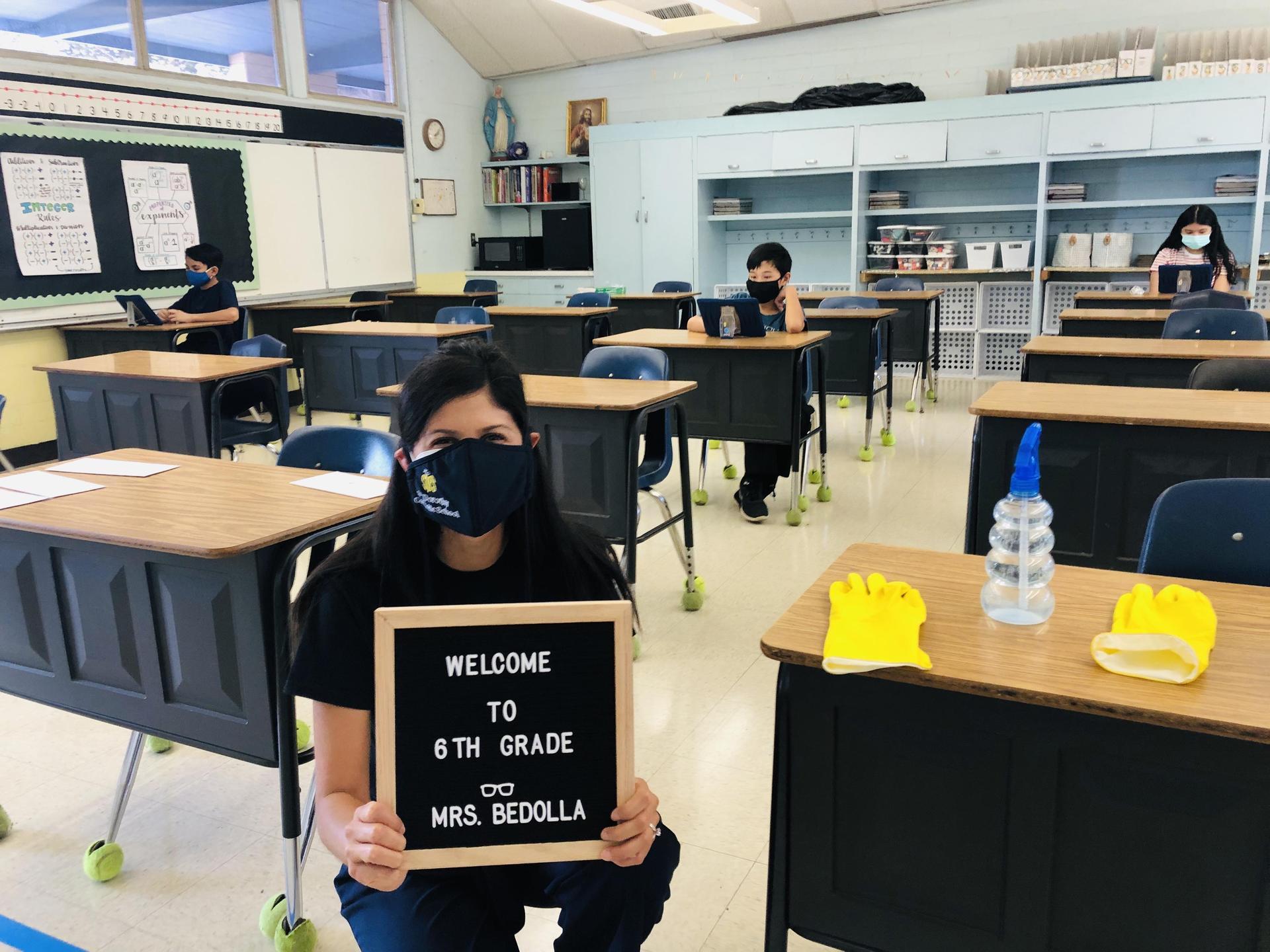 Sixth grade teacher, Mrs. Bedolla, welcoming students