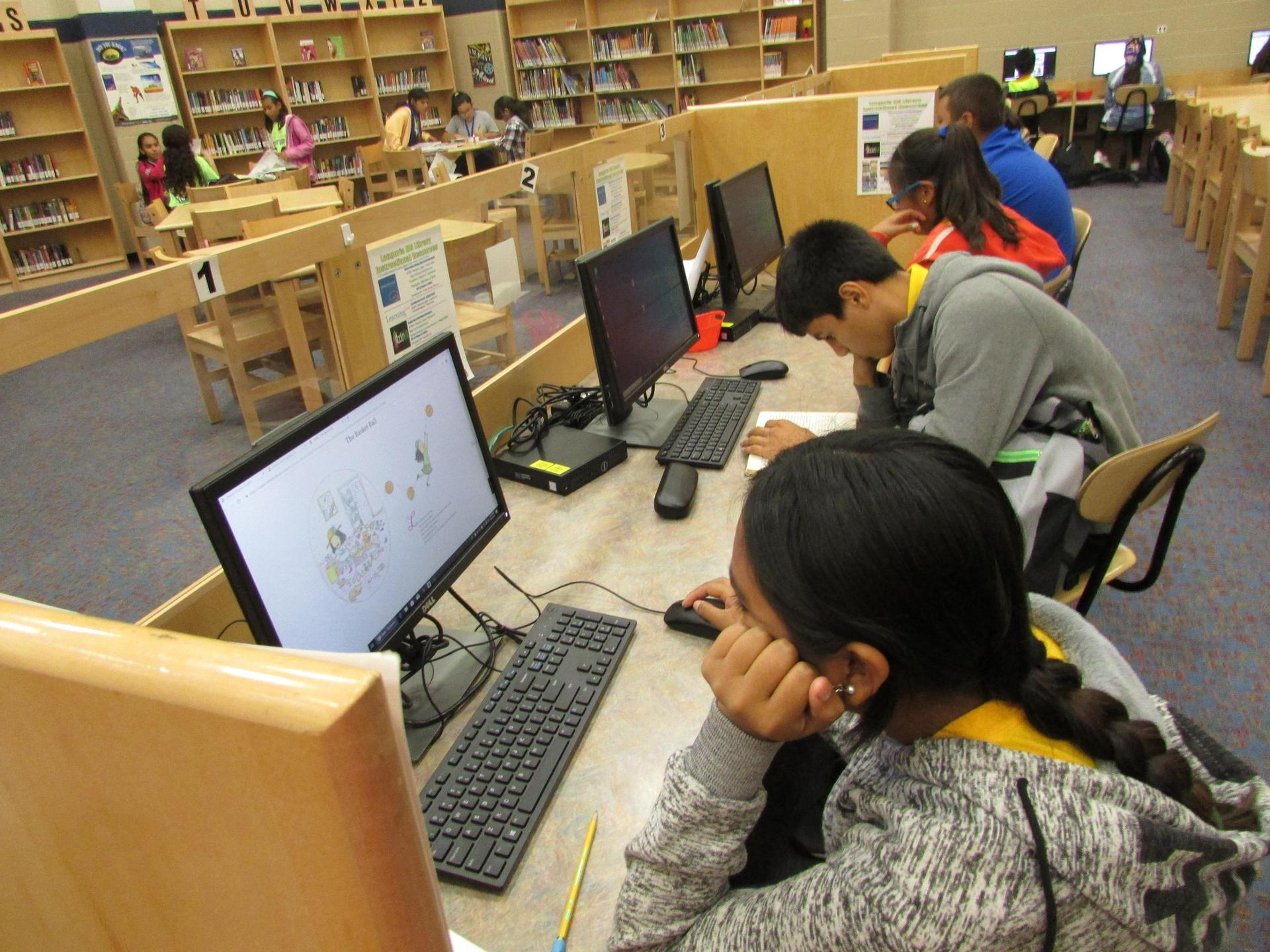 Students working at computers at the library.
