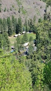 birds eye view of the camp nestled in a mountain valley