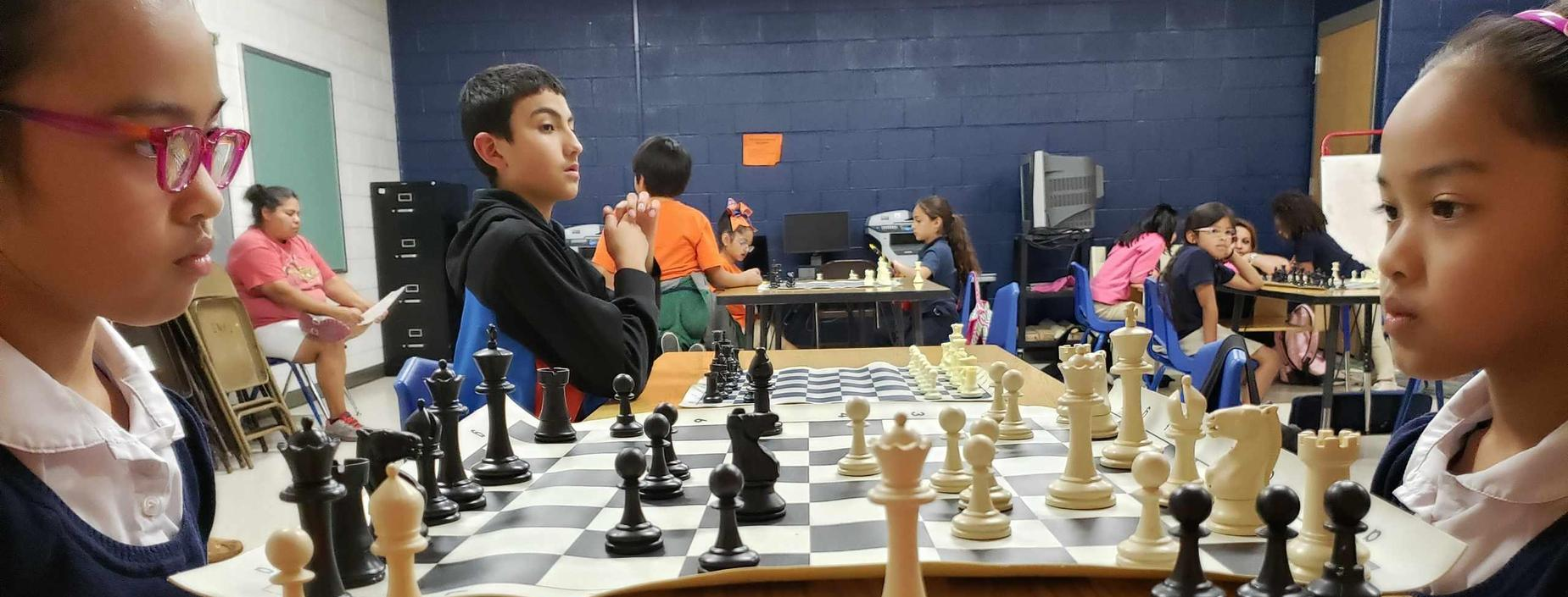 Students preparing for Chess Tournament during ACE Parent Open House