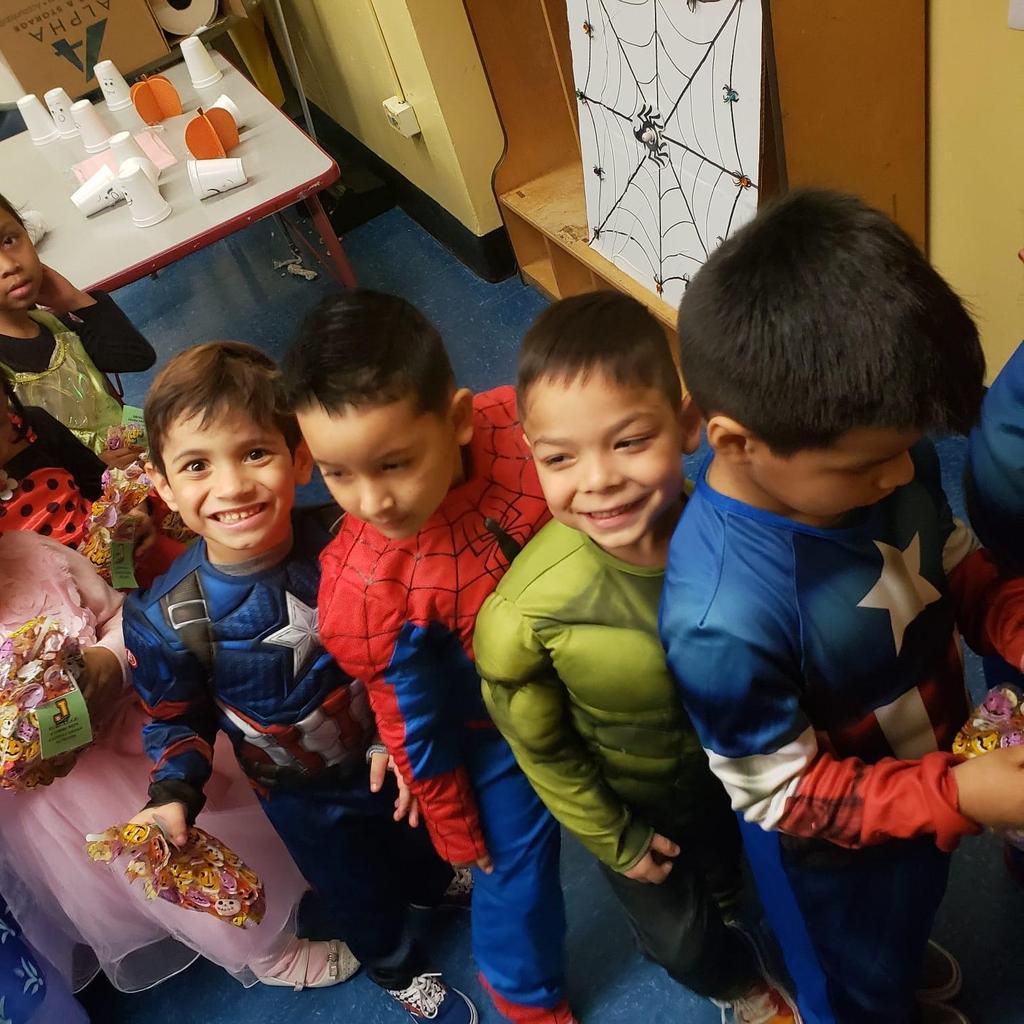 four little boys dressed as super-hero's