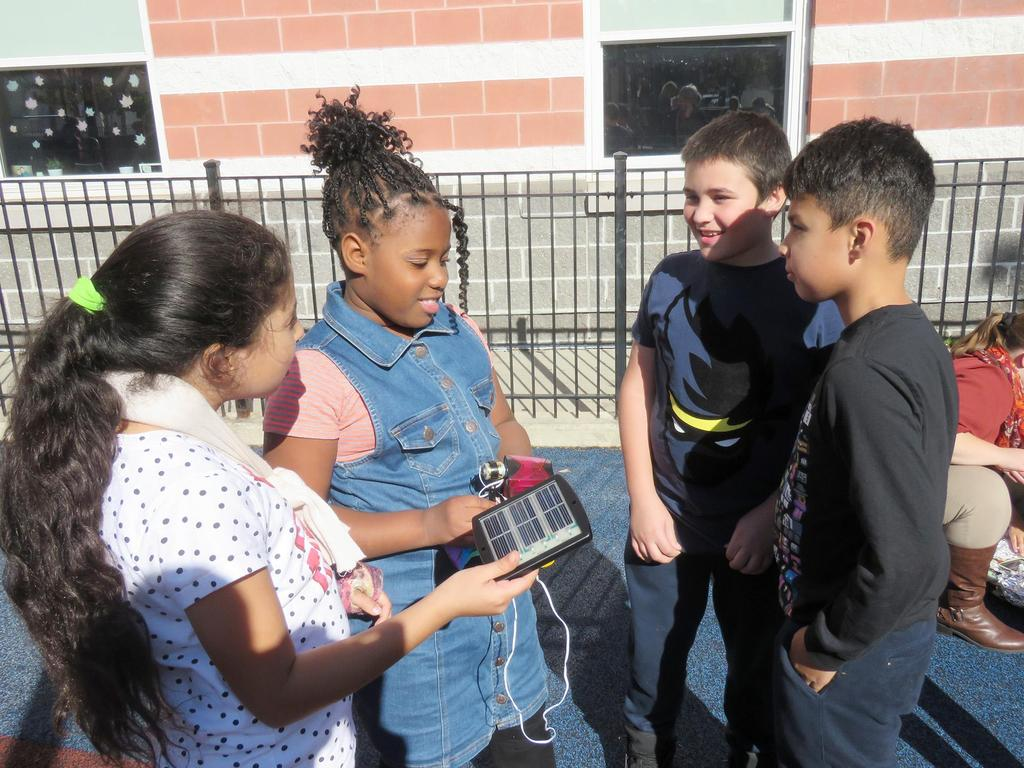 Students work collaboratively on a solar-power STEM project