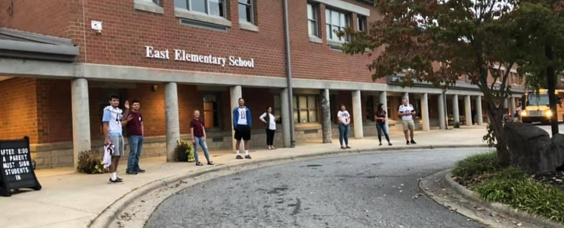 As part of Homecoming week, athletes went to East and greeted the students