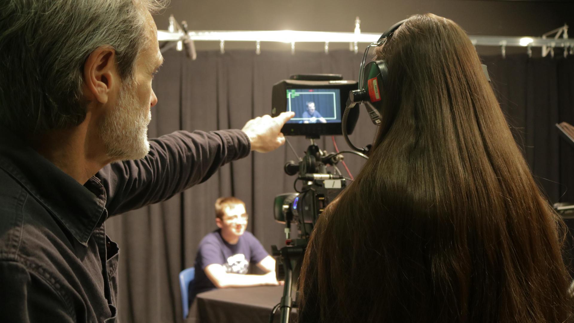 Teacher giving instruction on video shoot