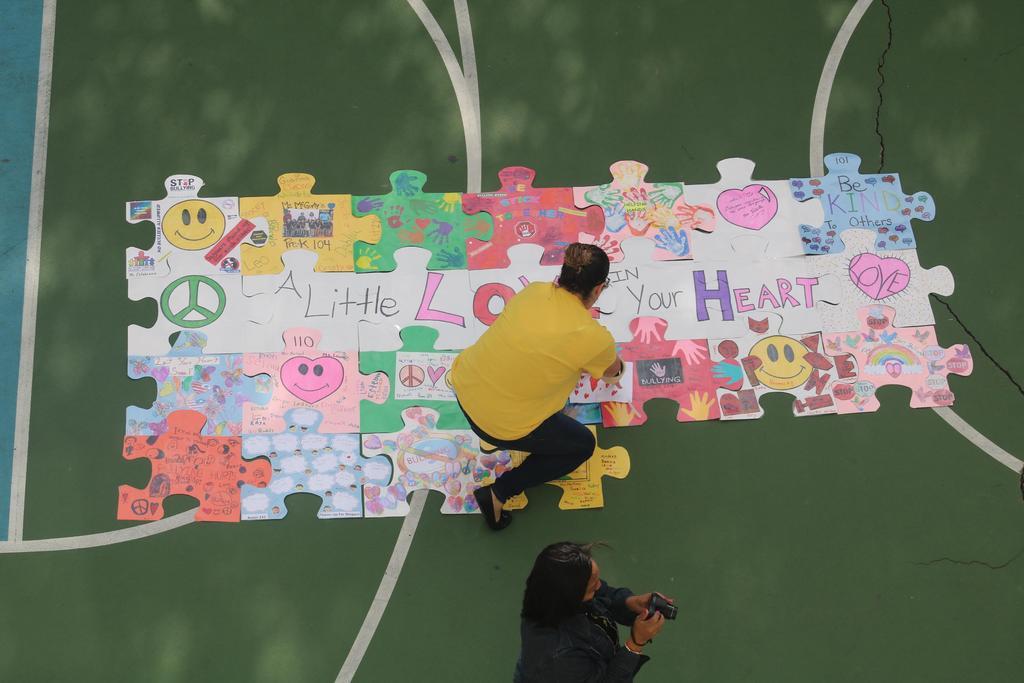teacher arranging the puzzle pieces together