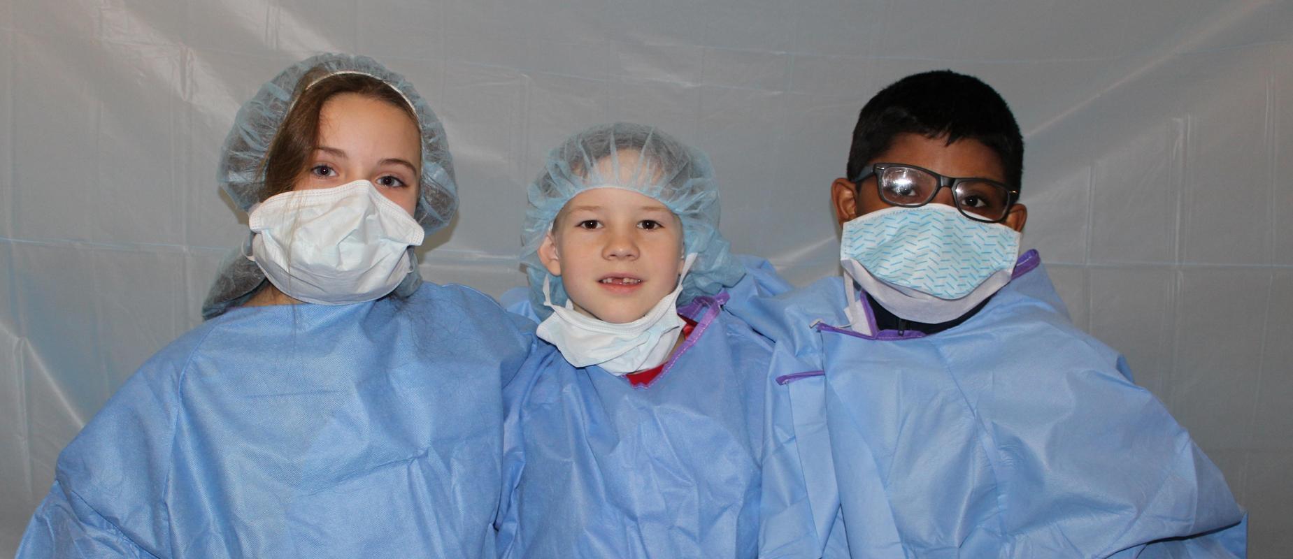 3 third graders in scrubs