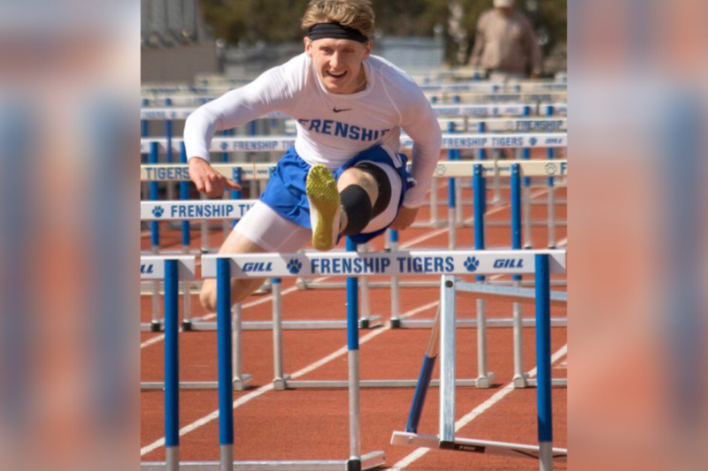 track student competing in hurdles