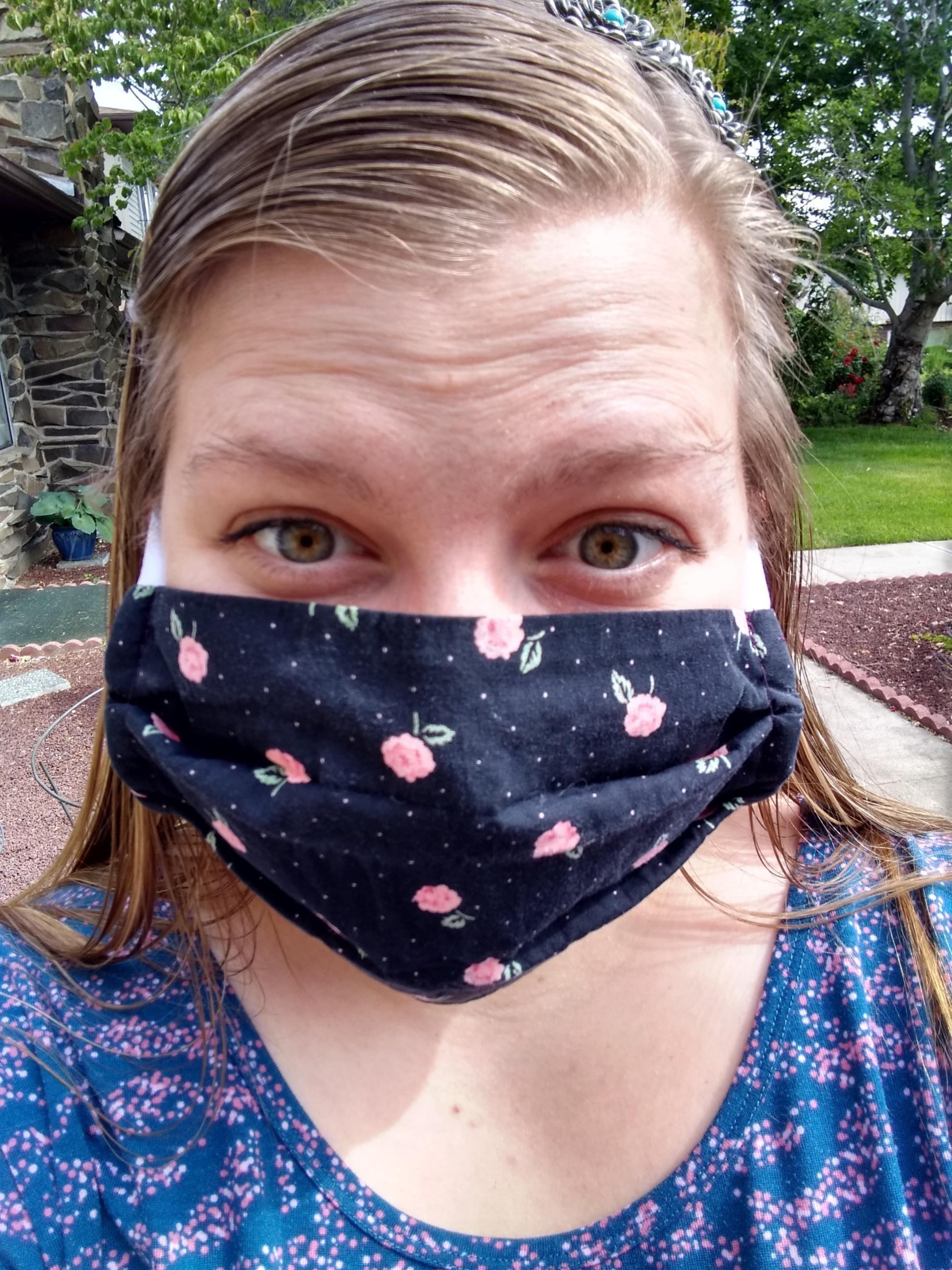 staff member selfie wearing mask