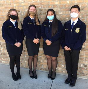 Four FFA students with masks on.