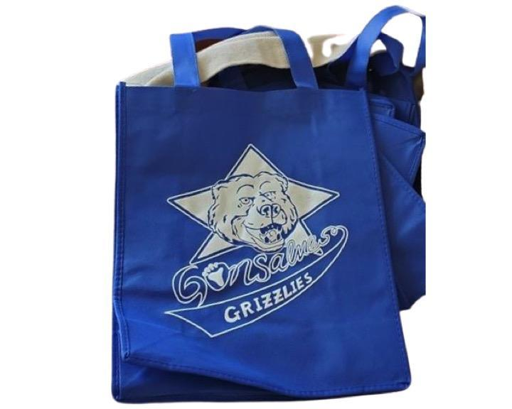 blue tote with gonsalves grizzly bear on it