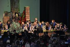 The Wicked Witch of the West and her flying monkeys performs in WSISD's district-wide musical performance of the