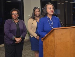 Photo of three Southern University employees addressing the City of Baker School Board to discuss a proposed agreement