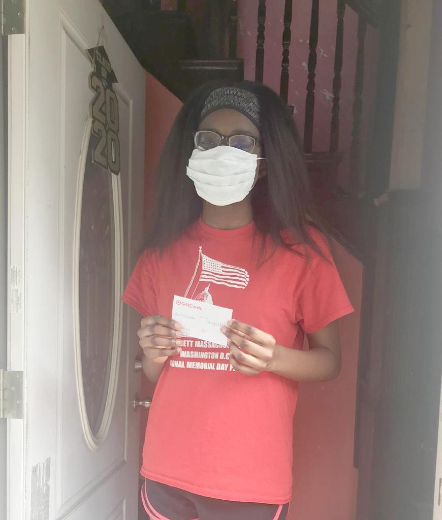 Student holds a gift card