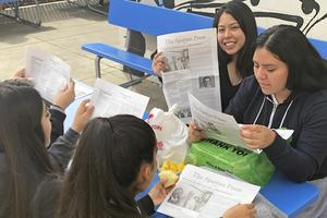 Students reading the 1st issue of The Spartan Press Newspaper