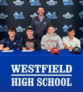 Westfield High School Track and Field Coach Christopher Tafelski joins track and field student-athletes as they sign Letters of Intent to continue competing at the college level.  From left, Steven Zucker – Ithaca College, James McCutcheon – Washington University in St. Louis, Ronald Melao – Stevens Institute of Technology, and Ajay Olson – Bowdoin College.