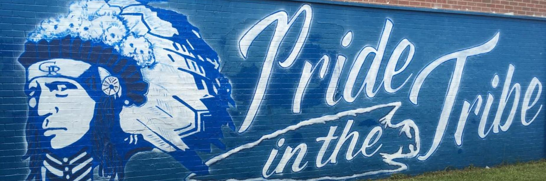Pride in the tribe painting on old gym