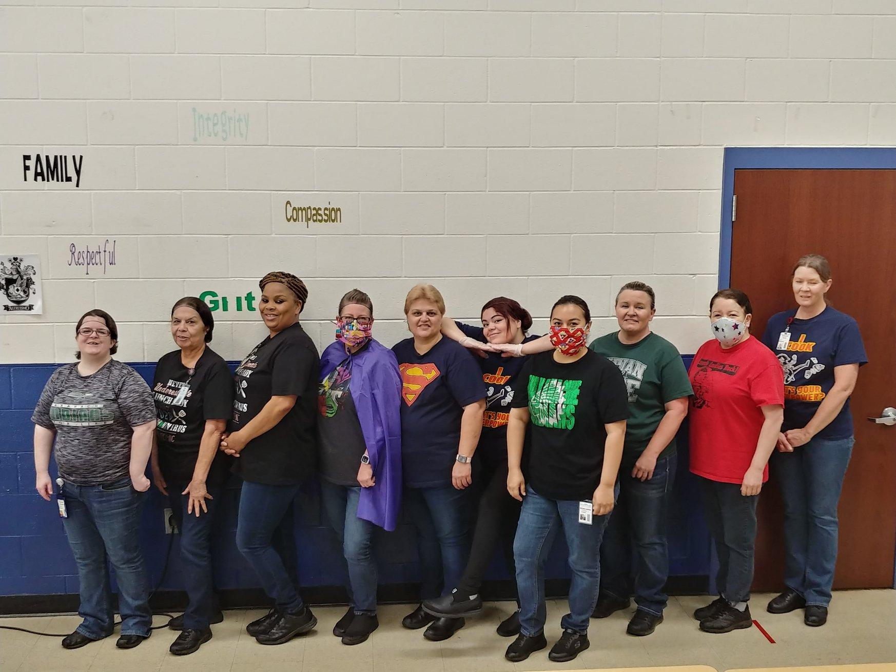group of ladies in super hero shirts