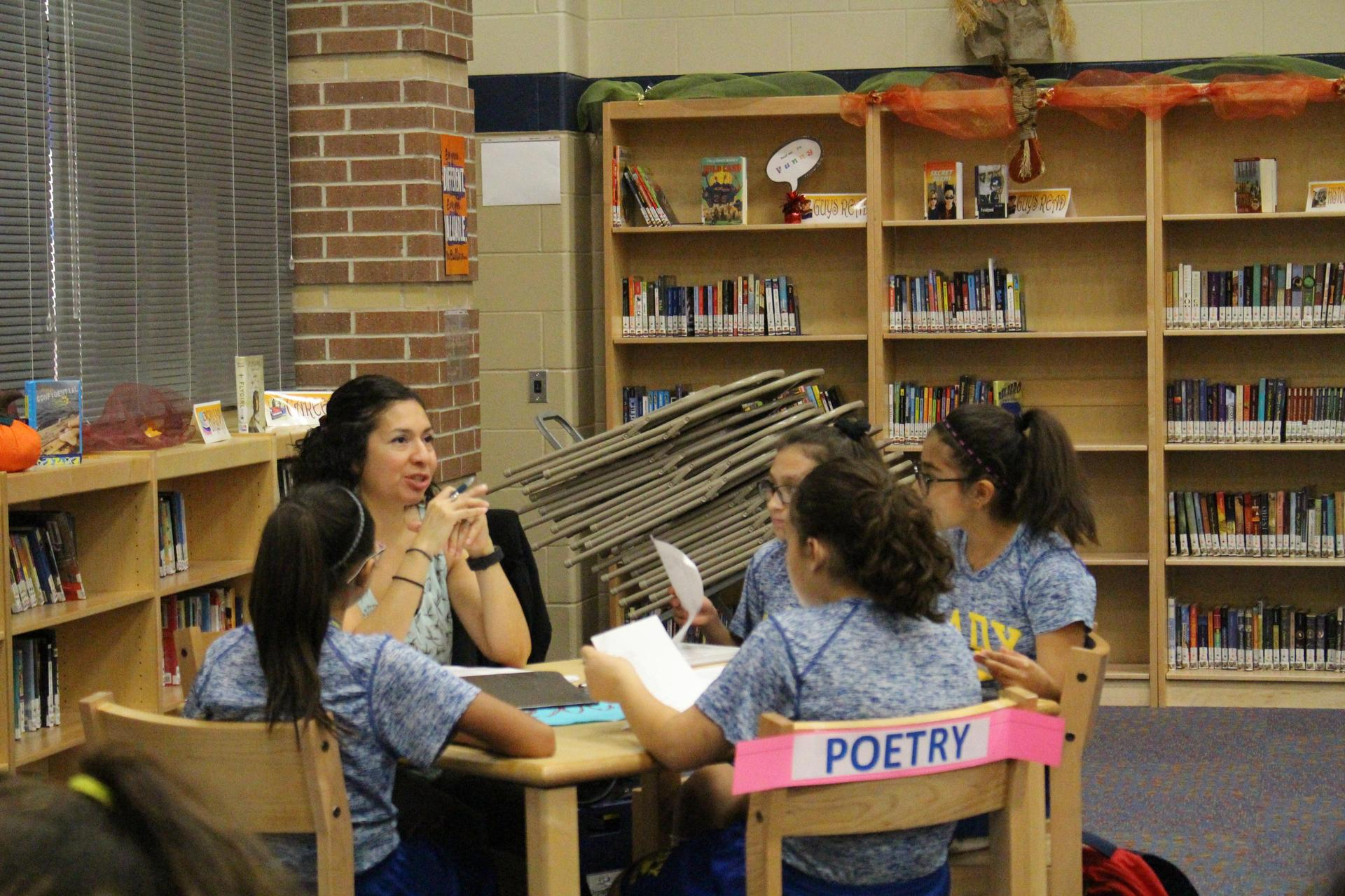 Mrs. Rosales explaining what Poetry event is about