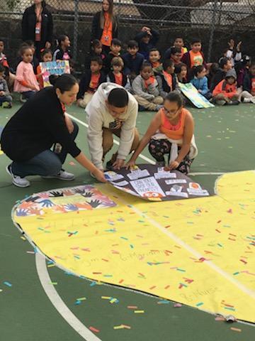 teachers placing class puzzle piece