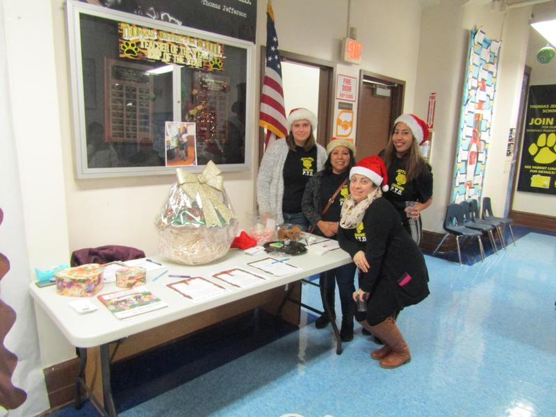 teachers aide dressed as santas helper at the raffle table