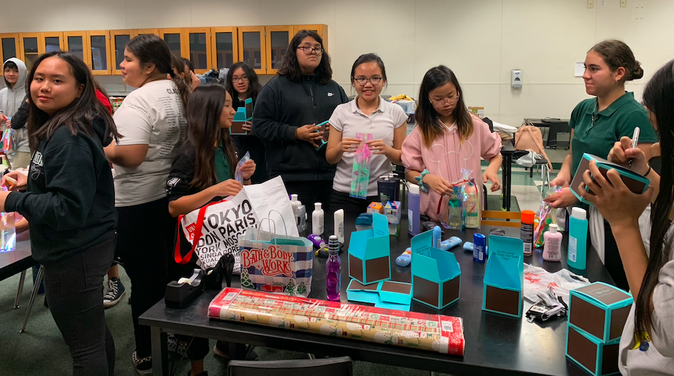 CCA students organizing toiletry items on desks.