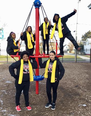 Picture of NSCW dancers playing on LHS playground.