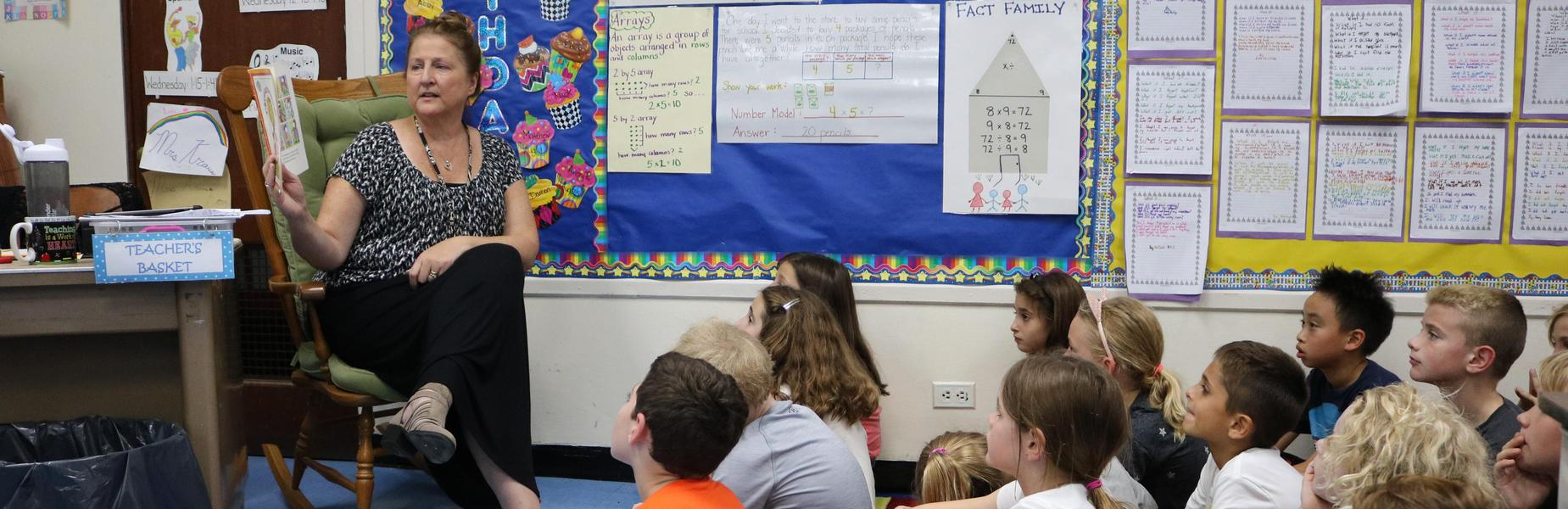 Wilson 3rd graders listen to teacher Lynn Kraus as she reads