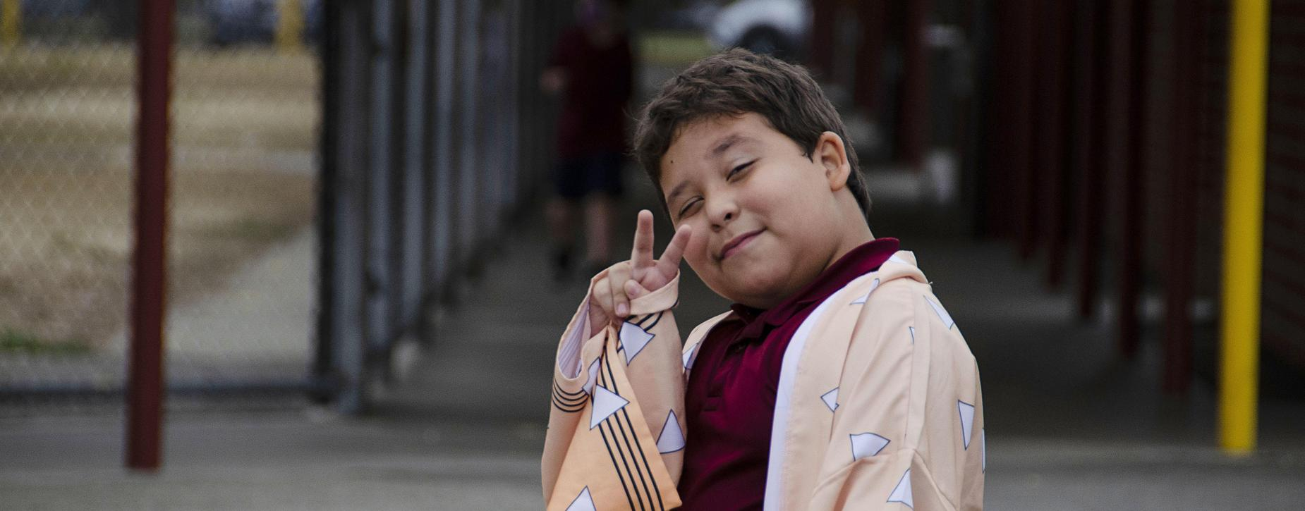 boy peace sign