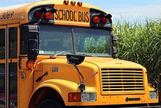 Front passenger side of yellow school bus.