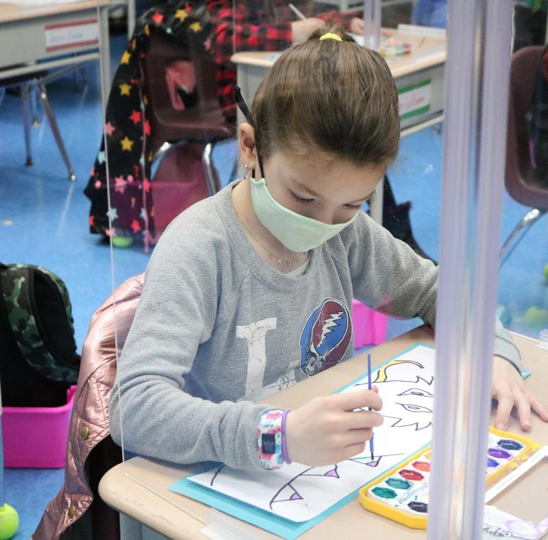 Photo of Franklin 2nd grader using watercolors to paint the legendary Chinese Dragon, during China Day activities.