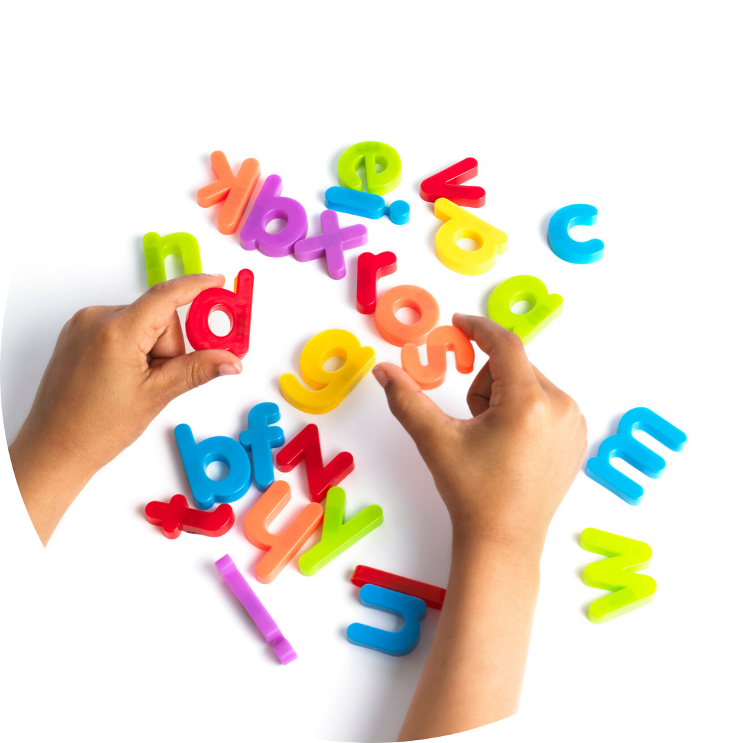 hands holding magnetic letters