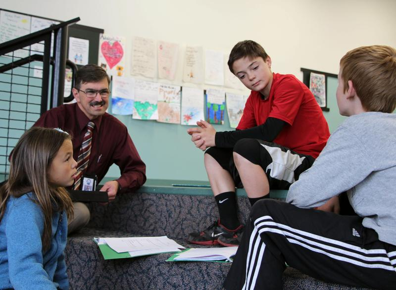 Superintendent Snowberger engaged with students
