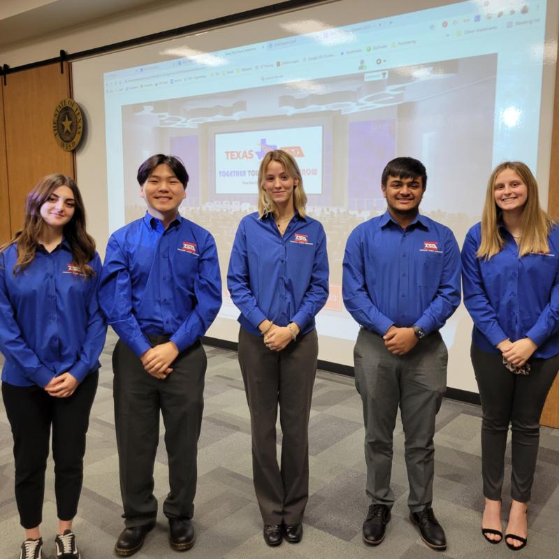 group of 5 teens in matching blue TSA shirts