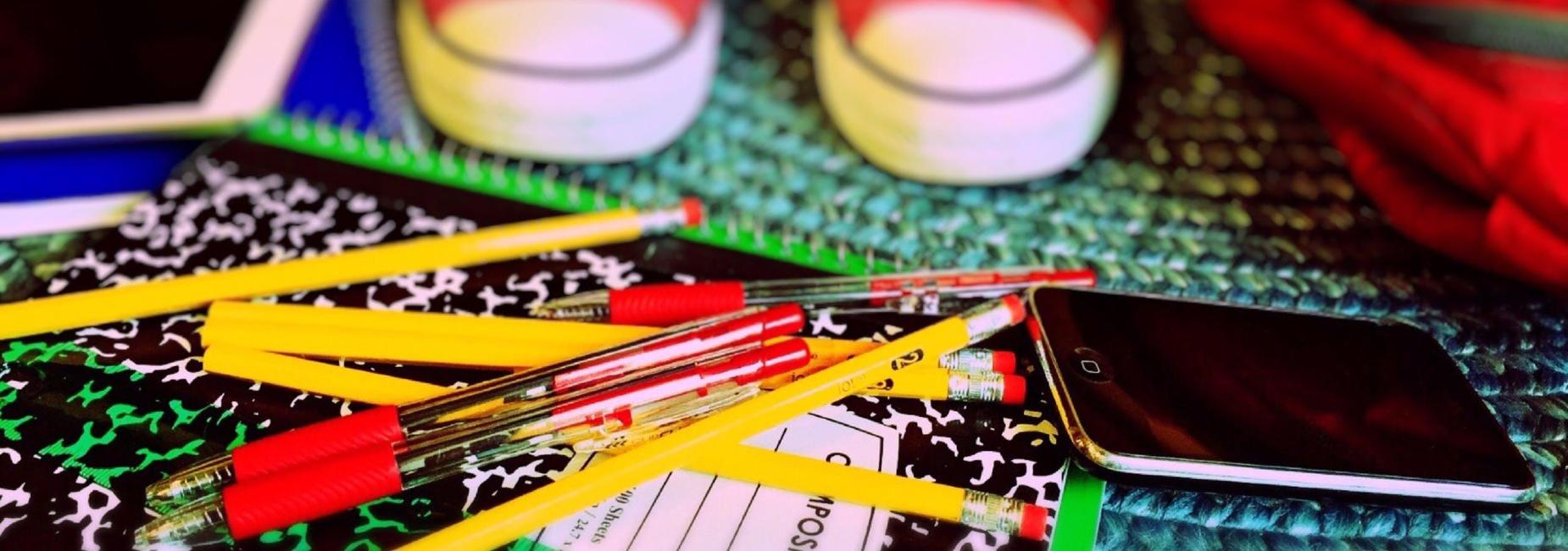 Pencils and pads on floor
