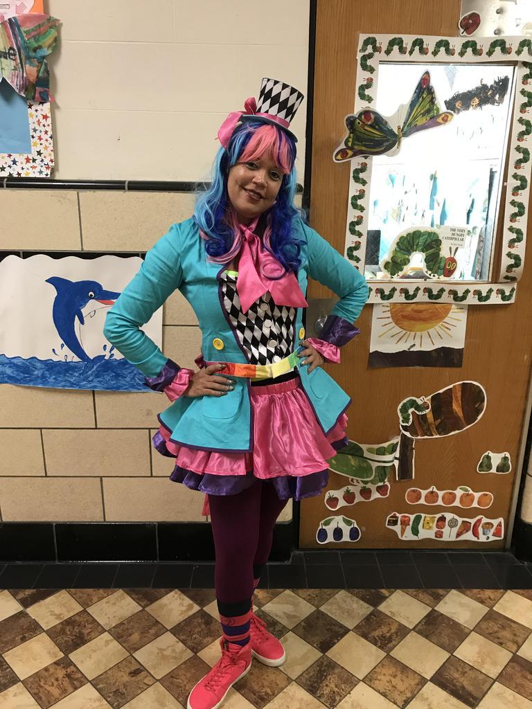 Happy clown teacher aide enjoying halloween