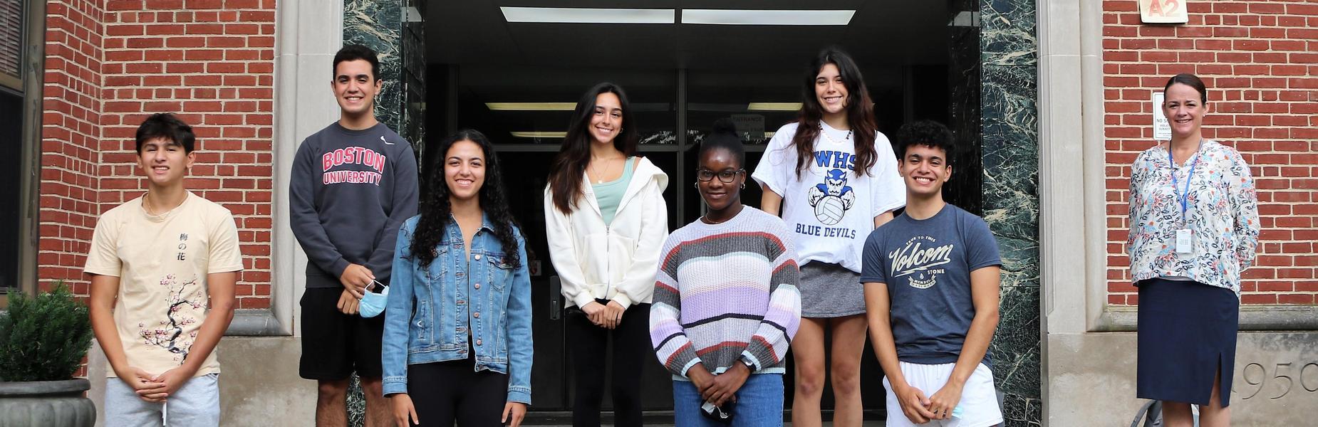 WHS Principal Mary Asfendis (right) congratulates College Board Recognition Program Scholars.  From left:  Mateo Belran, John González, Amira Lee, Victoria Vaca, Celia Frank, Taylor Addis, and Manuel González.