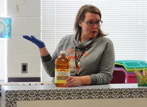 Ms. Nowinsky talks to students about the state's apple and blueberry production.
