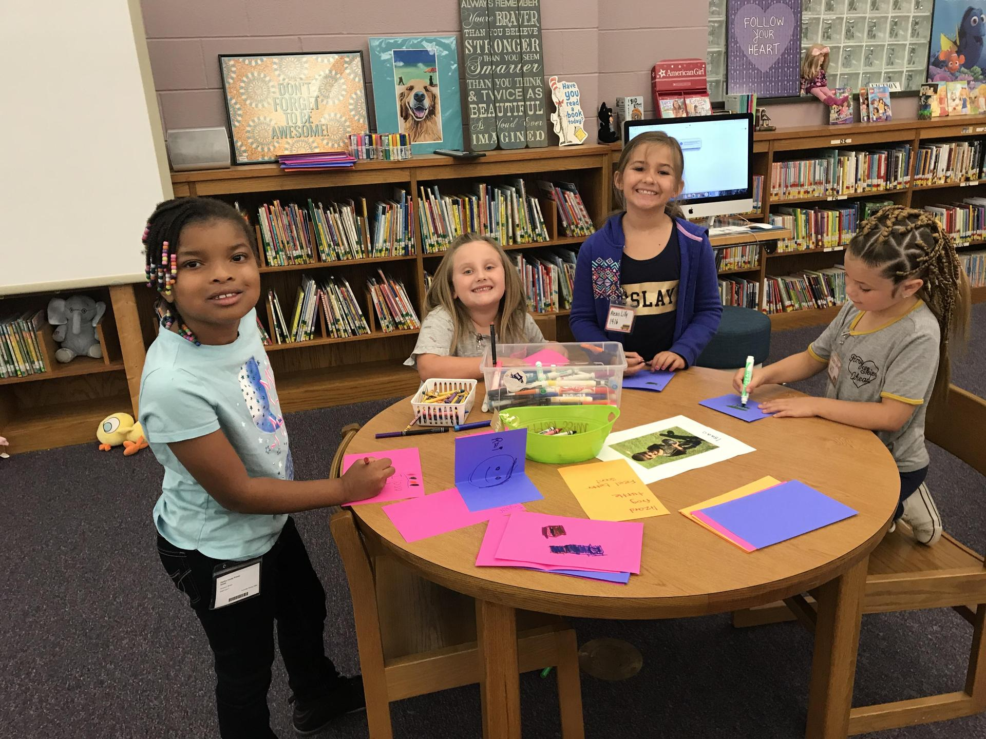 Girls drawing and making cards