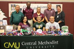 Pictured are MHS Track runner, Alex Cordova, signing with CMU. His parents, coaches, athletic director and CMU representative are pictured.