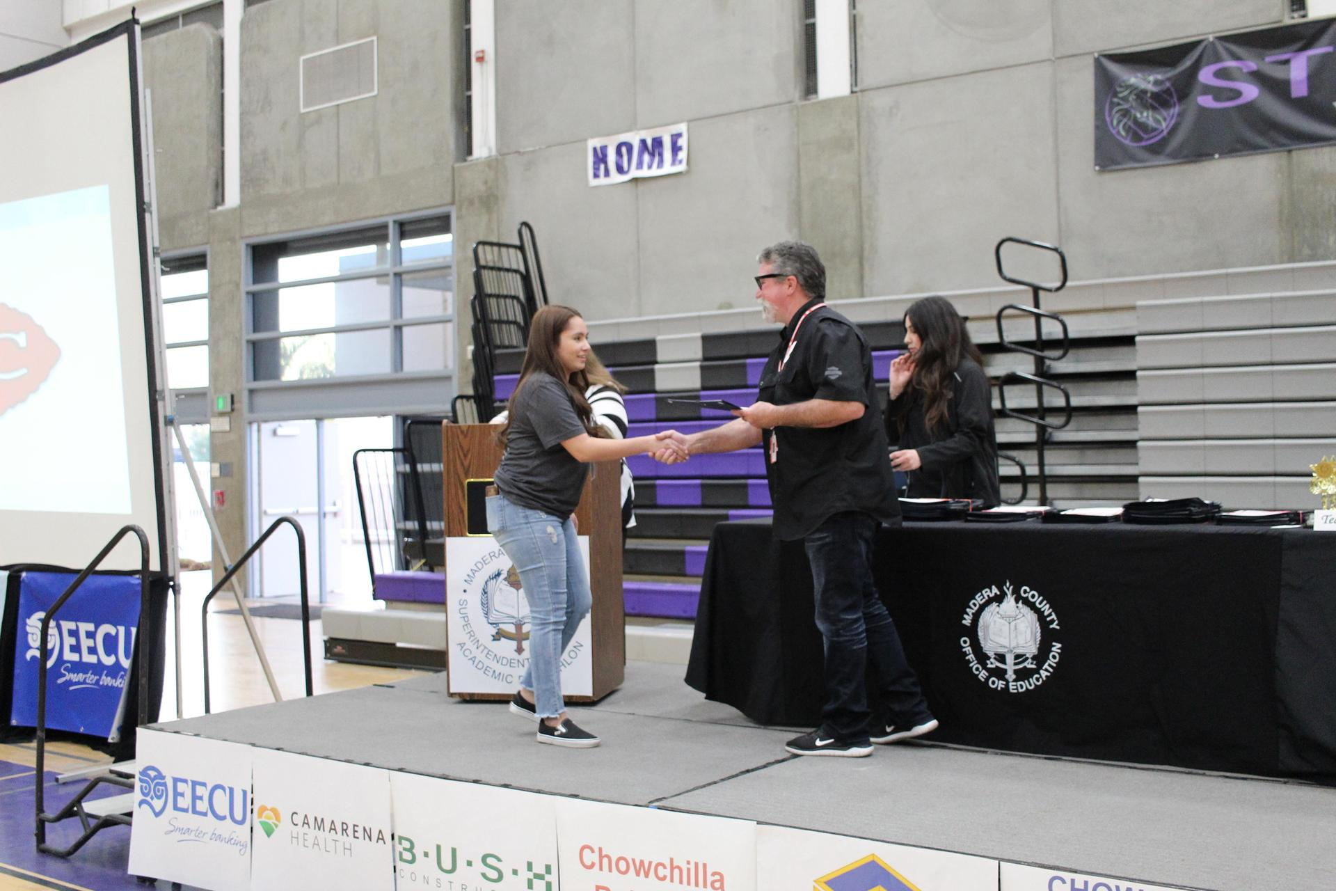 Jenesis Borrego gets participation award from CUHSD Superintendent Ron Seals