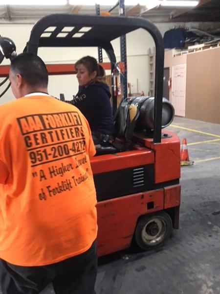Student driving fork lift