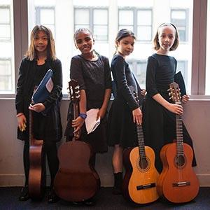 4 girls with guitars