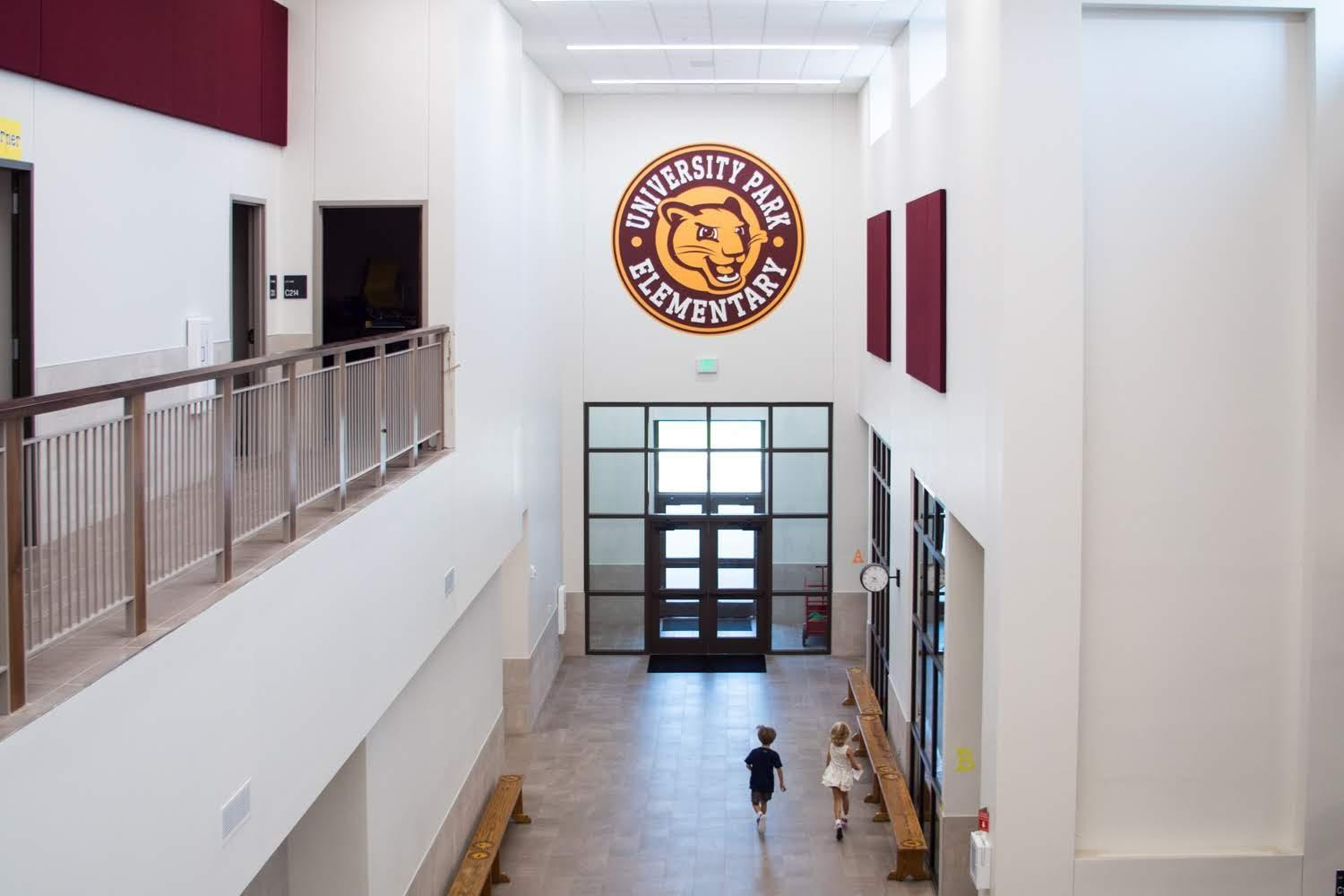 University Park hallway and logo crest on wall