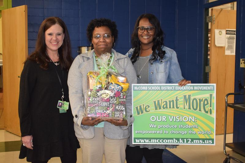 Higgins employee receives District's Random Acts of Kindness Basket.
