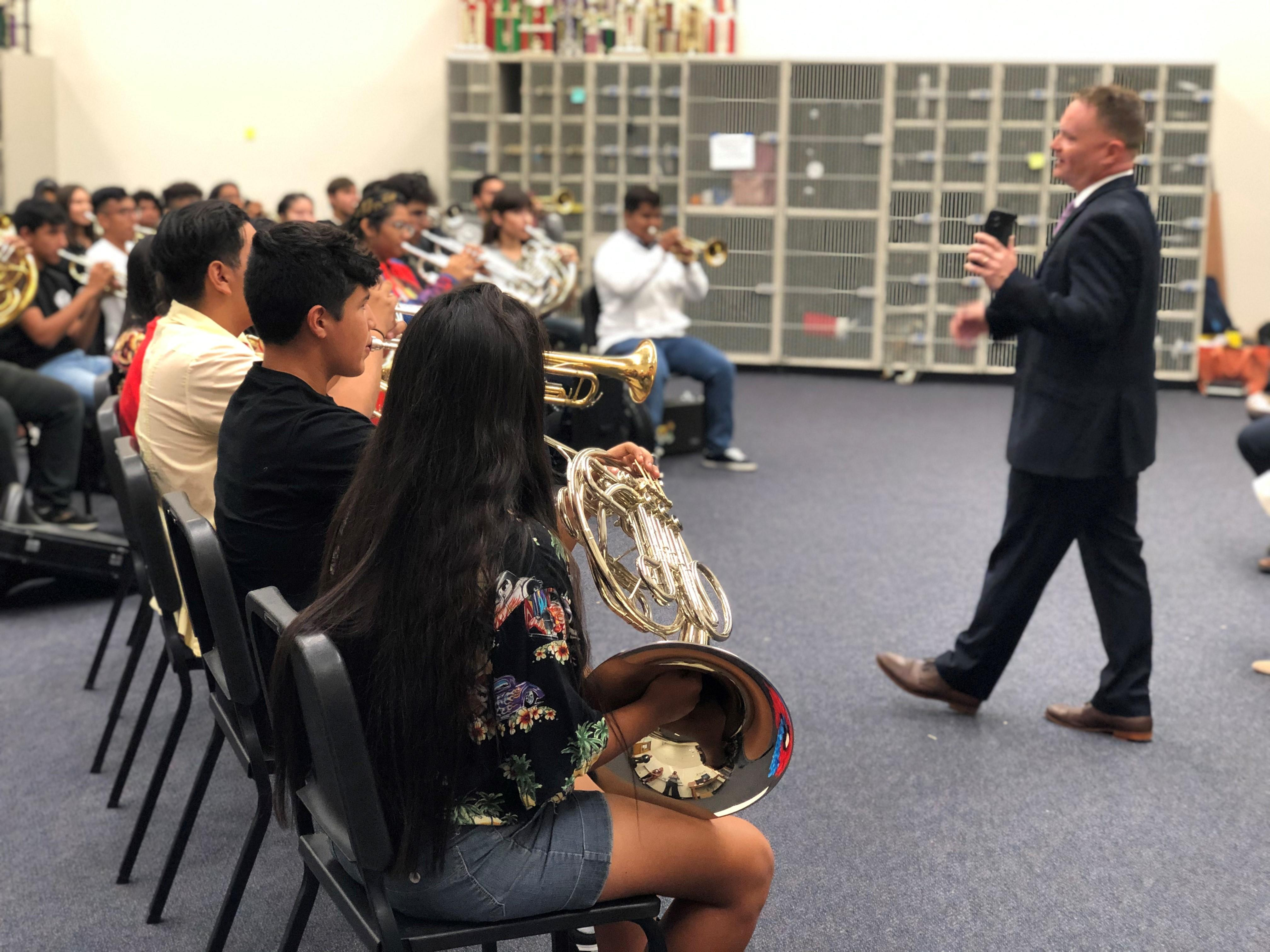 The President's Own Band conducts a workshop with students