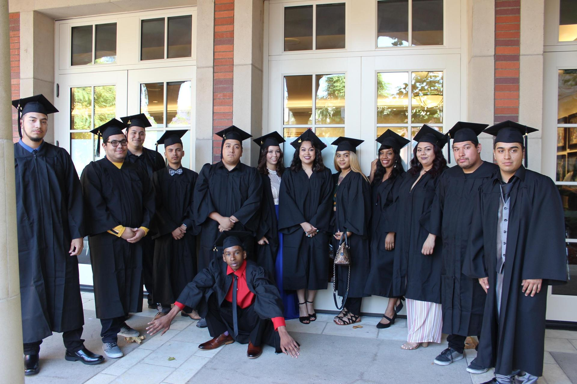 Avalon site Class of 2018 pose with grad caps
