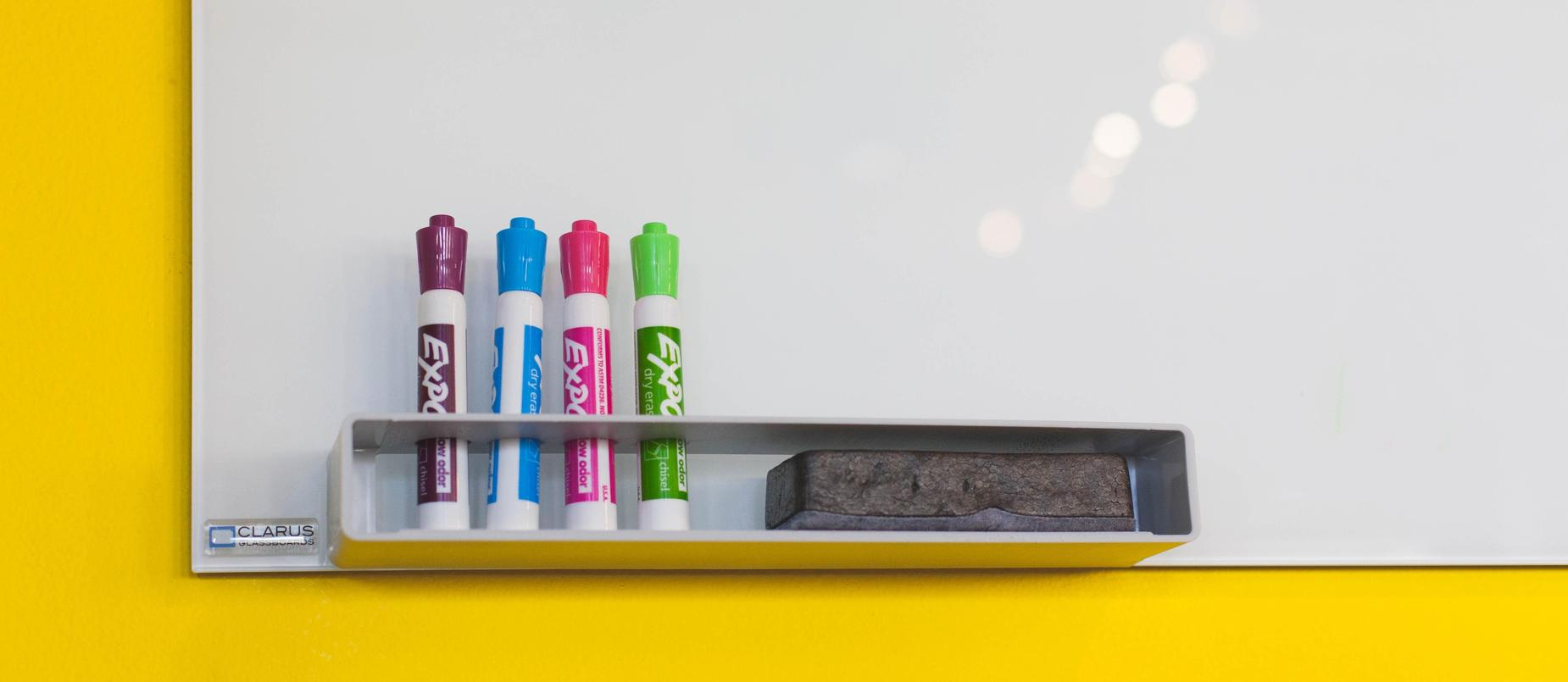 white dry erase board with markers