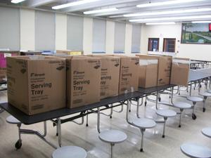 Boxes to be packed with student meals for delivery.