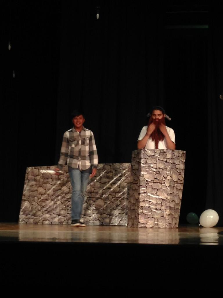 Two students performing a play.