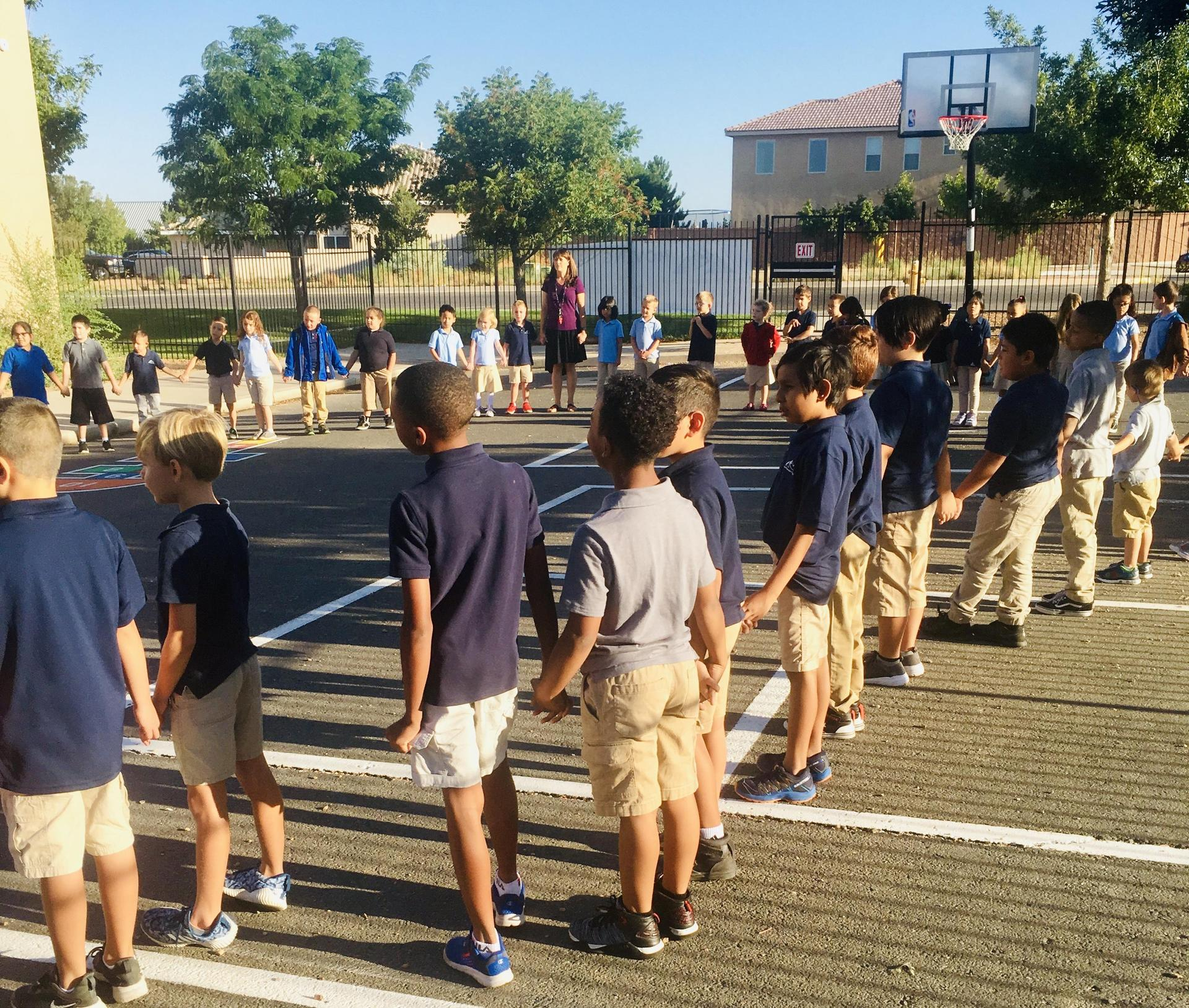 Students create a circle for Monday morning circle.
